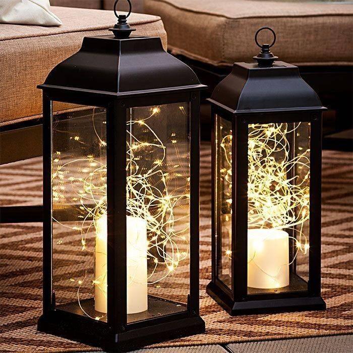 fairy lights inside black iron lantern casing