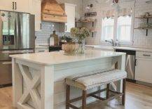 cottage-style kitchen island set up with white wood and light wood accents
