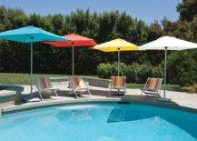 multicolored patio umbrellas by pool