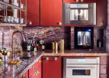 deep red kitchen cupboards with multicolored granite