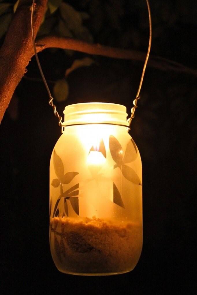 mason jar lantern hanging from tree