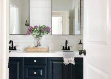 Double mirrors above a vanity sink