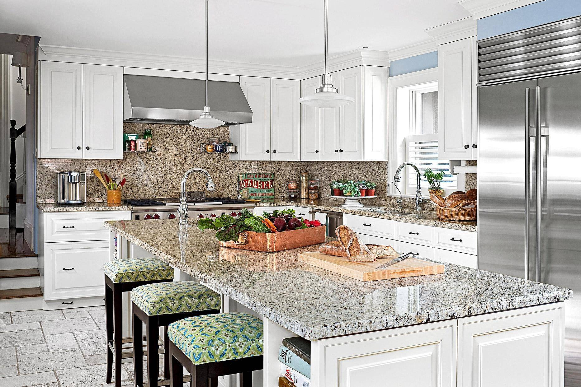 speckled granite kitchen island with colorful stools