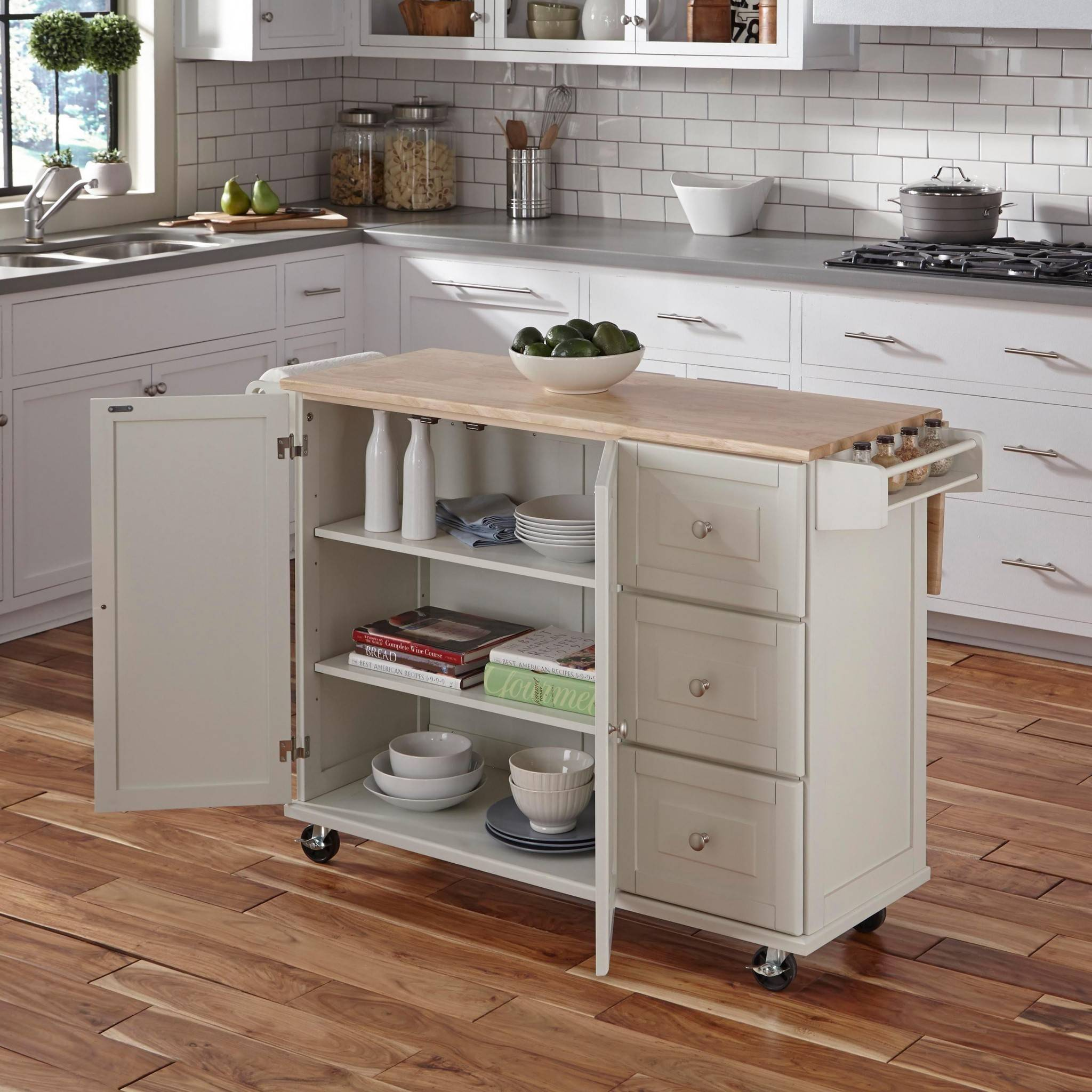 kitchen island on wheels with open cupboard doors