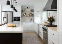 black and white kitchen paint theme with butcher block counters
