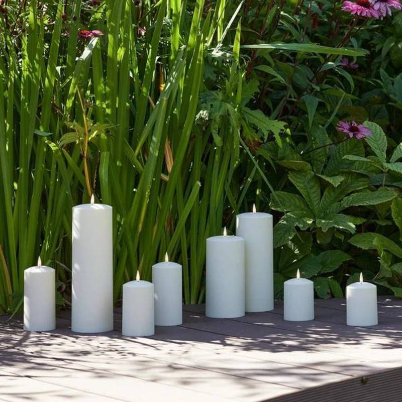 candles on patio against grass