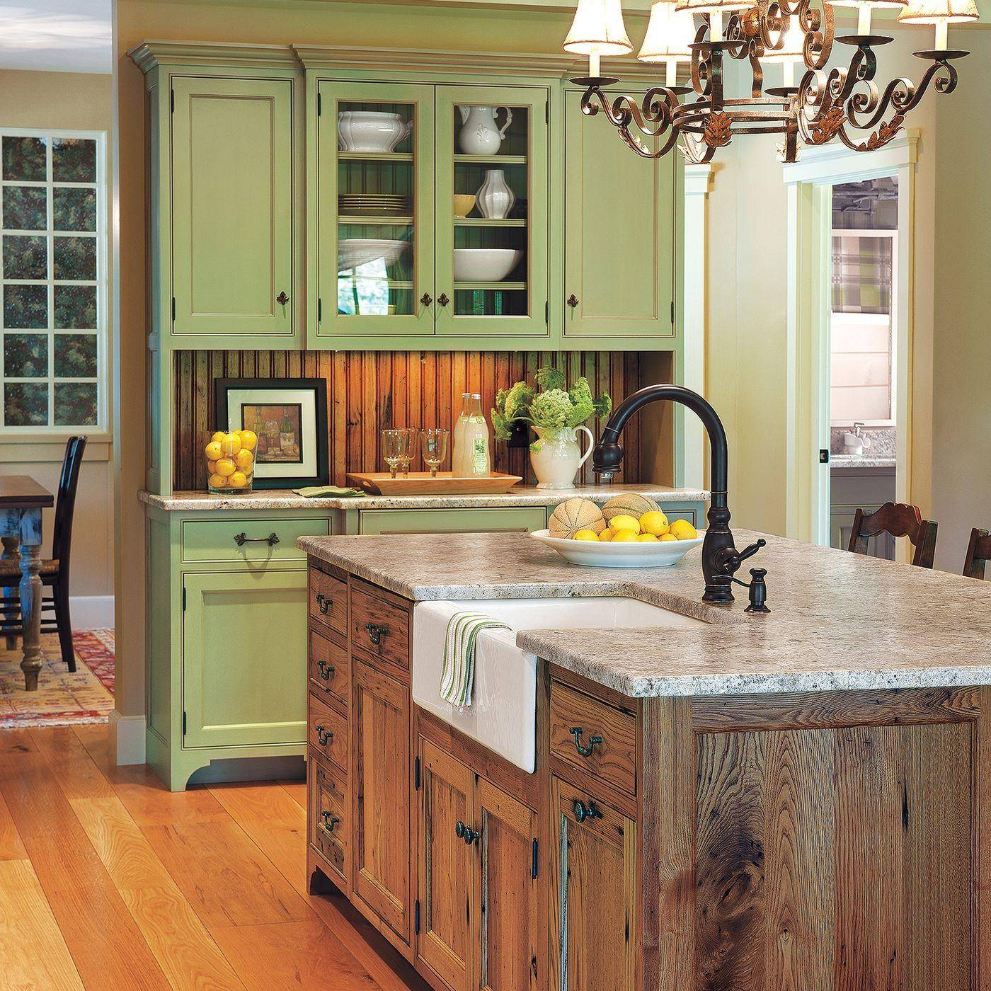 distressed wood kitchen island with green cabinets