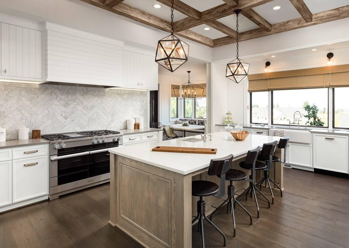 wooden family style kitchen island with chevron marble backsplash