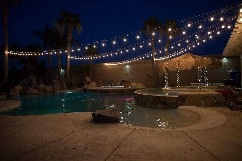 pool at night with string lights overhead