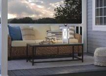 white lantern on table against patio furniture