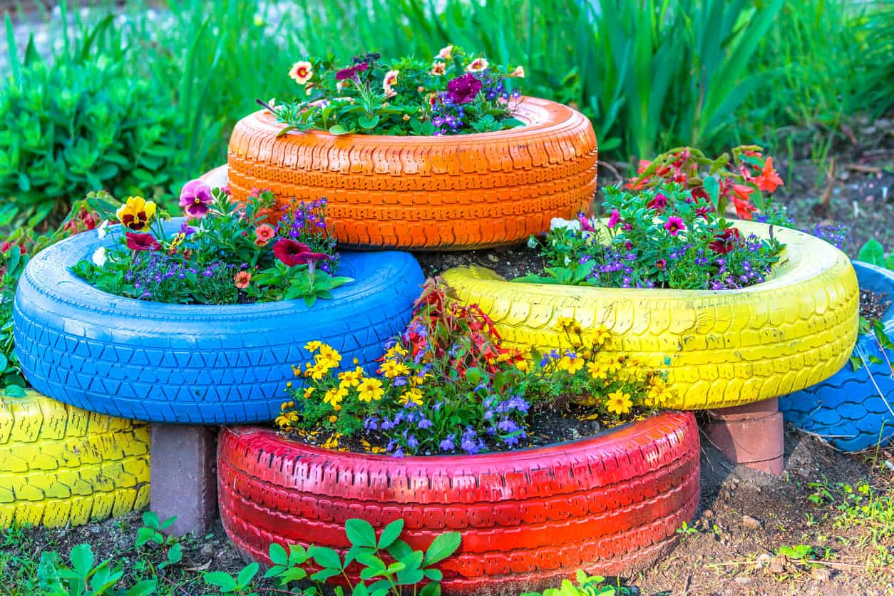 multi colored upcycled tire planters