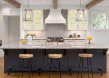 dark kitchen island with marble counter tops