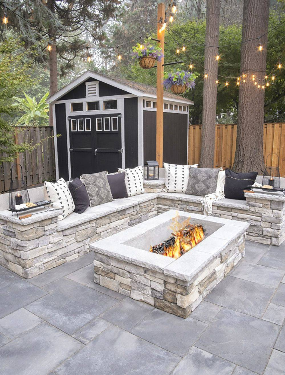stone firepit with stone couch surrounding it