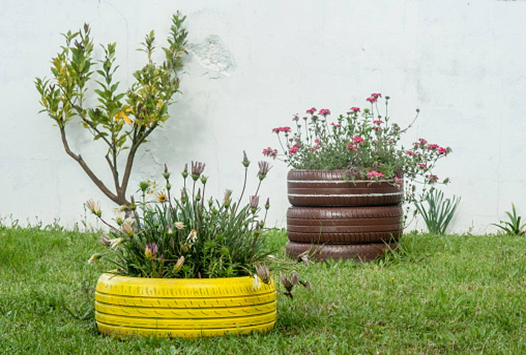 yellow and brown painted tire planters