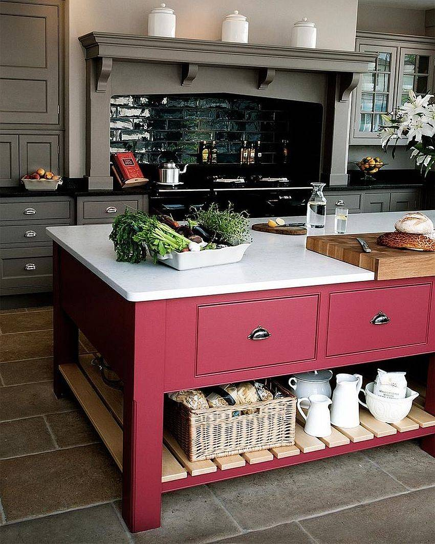 red kitchen island with bright white countertops