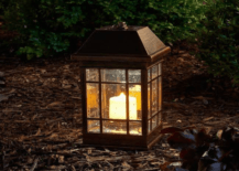 black rod iron lit lantern on ground