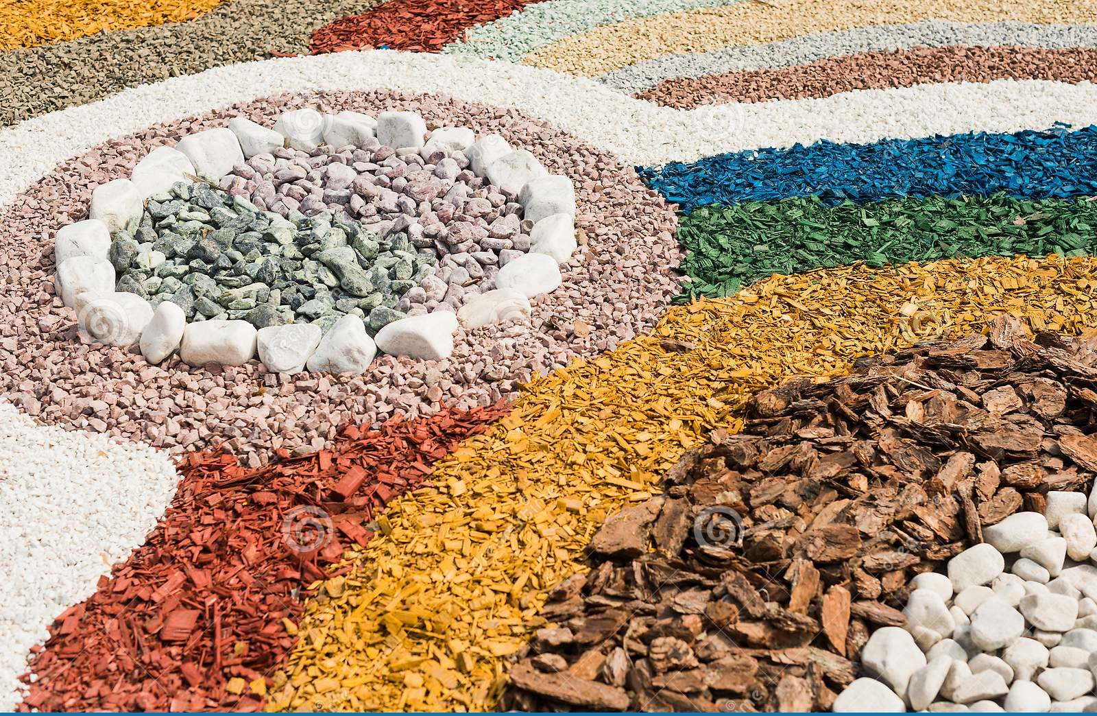 stones and colored woodchips combine to make design