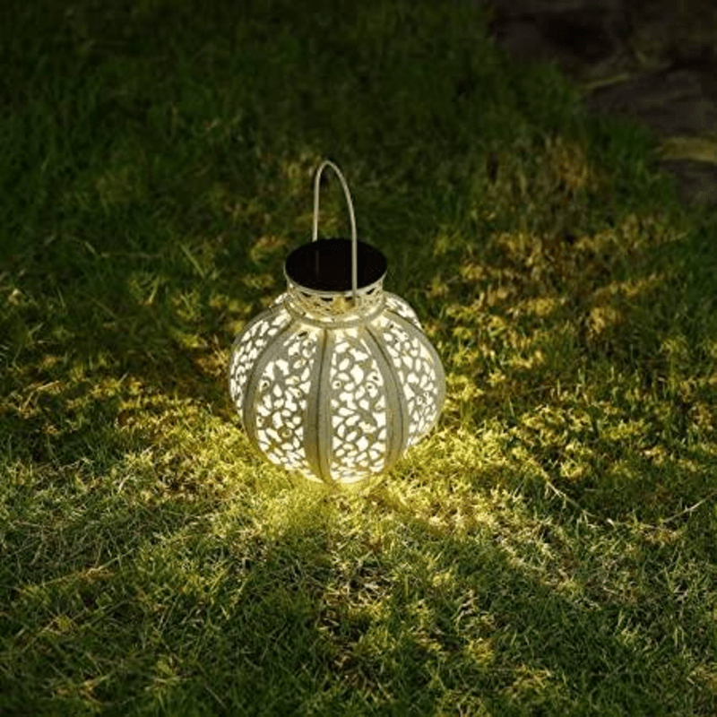 solar lantern glowing on grass