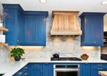 bright blue kitchen cabinets against white countertops