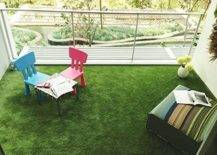 faux grass on balcony with colorful patio furniture