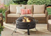 lit firepit with beige outdoor couch