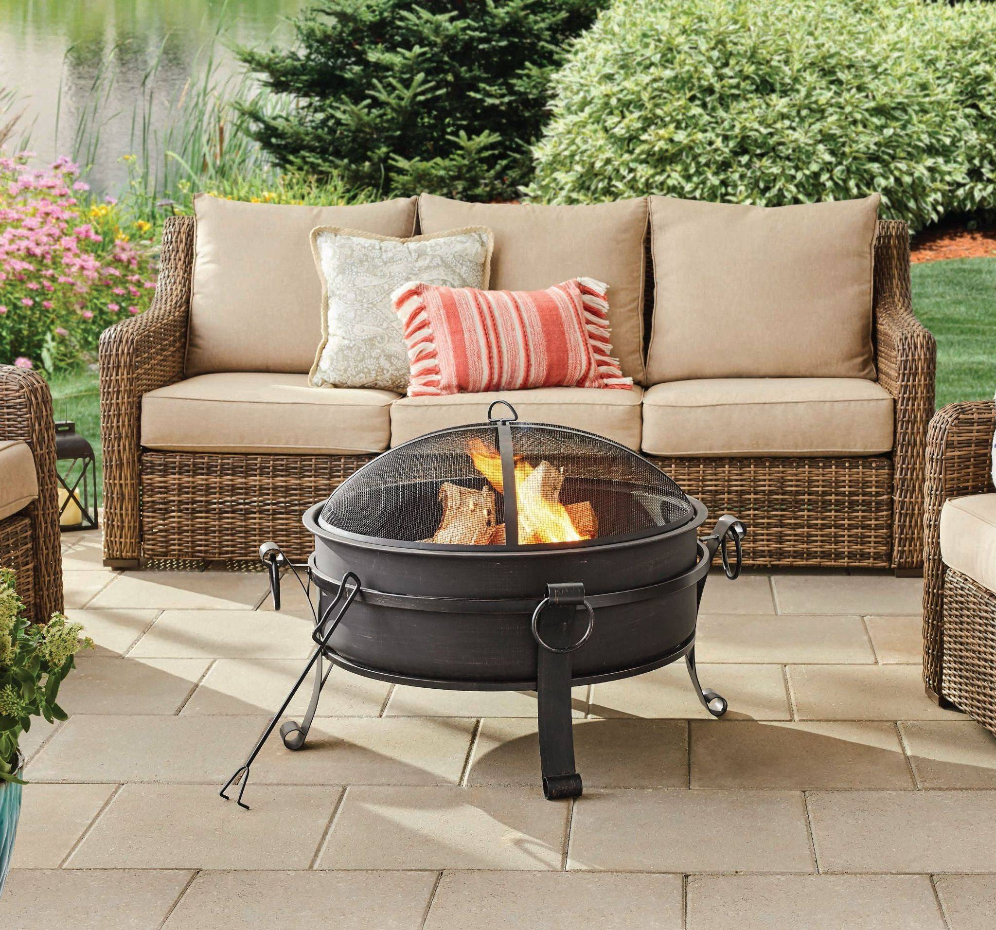 lighted firepit on stone patio