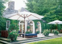 umbrella-covered patio in spacious backyard
