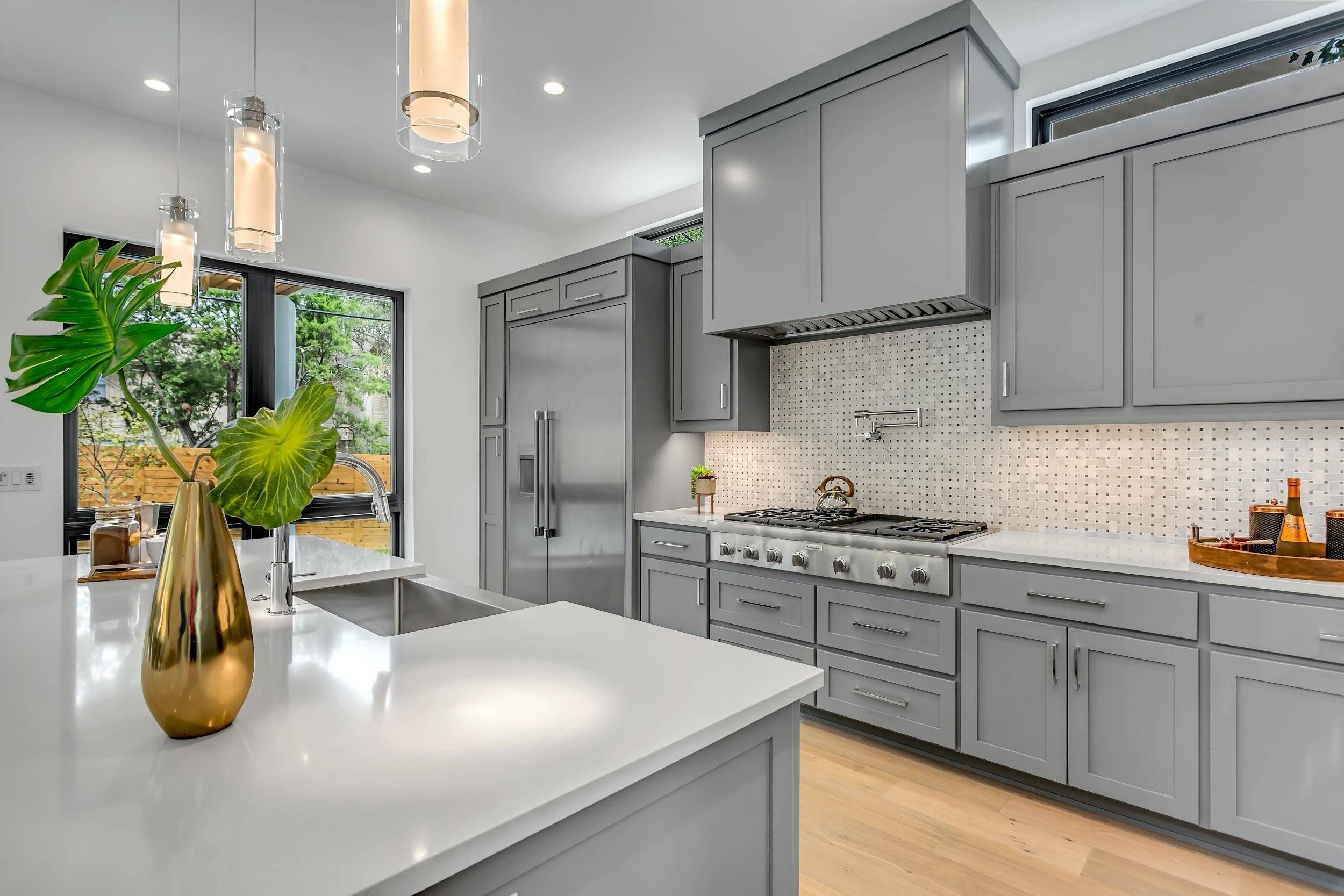 Dove grey granite countertops among shades of grey kitchen decor