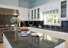 dark granite against white kitchen cupboards