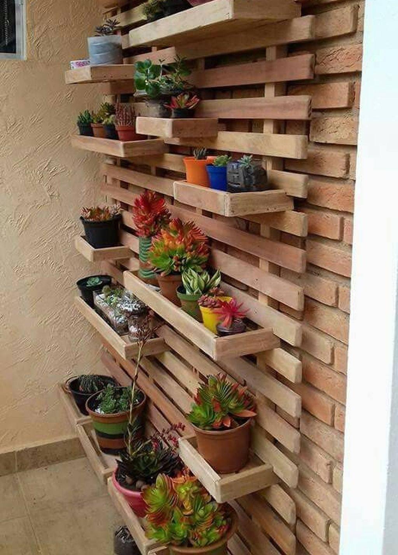 vertical hanging garden against wooden slat