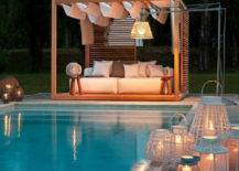 pool gazebo lounge area lit up at night