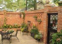 brick privacy fence backyard patio
