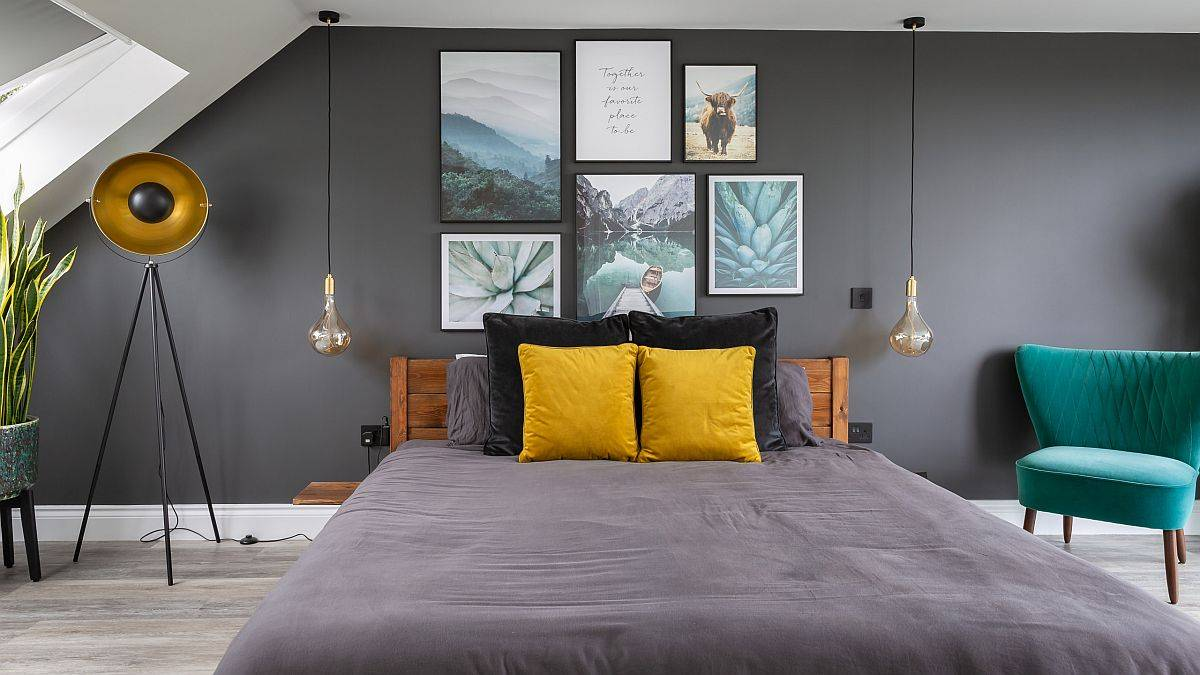 Accent-pillows-and-wall-art-add-color-to-this-cool-bachelor-bedroom-in-trendy-gray-73362