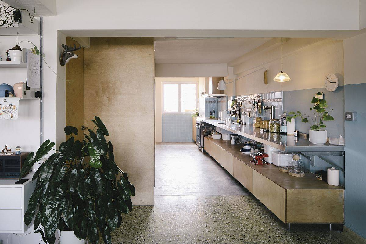 Bespoke-cabinetry-blue-wall-tiles-and-Terrazzo-flooring-preserve-some-of-the-original-traits-of-the-apartment-72545