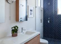 Blue-tile-in-herringbone-layout-makes-the-biggest-impression-in-this-contemporary-bathroom-25689-217x155