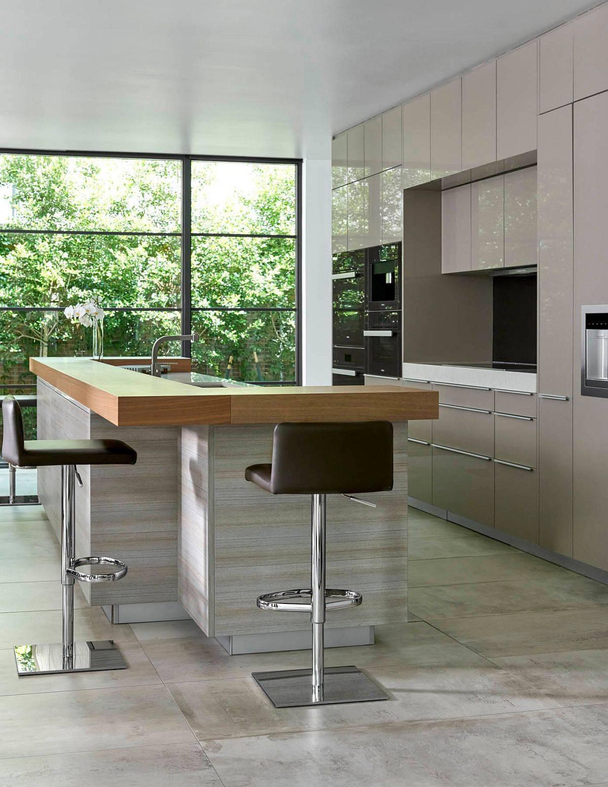 Breakfast-bar-in-wood-wraps-around-the-kitchen-island-in-style-63790