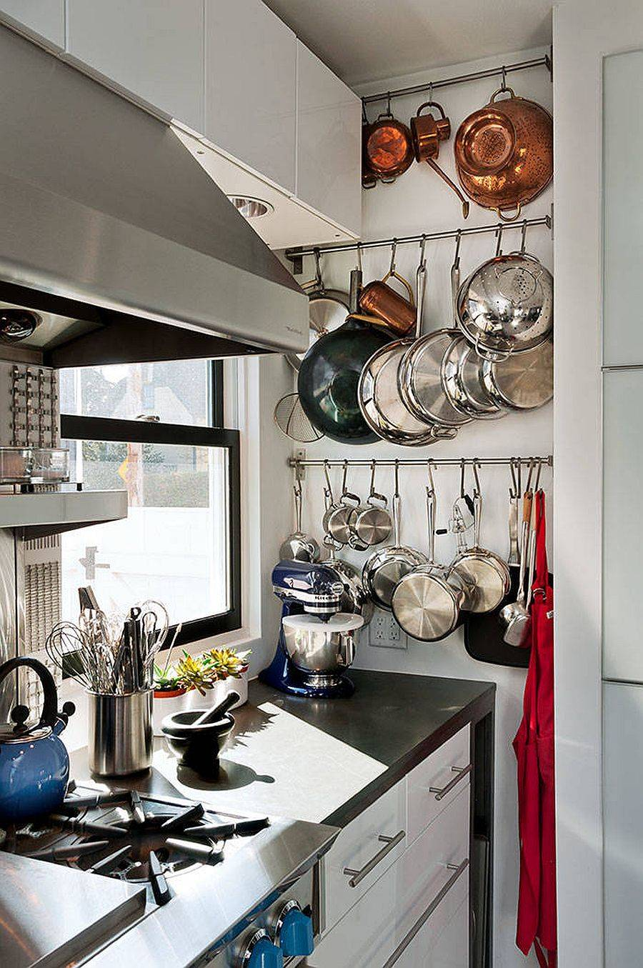 Corner-space-is-utilized-to-the-hilt-in-this-tiny-white-kitchen-with-ergonomic-utility-rails-26970
