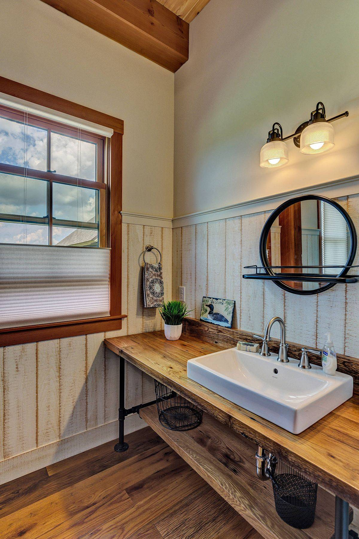 Custom-metal-and-wood-vanity-and-sink-in-the-bathroom-accentuates-its-farmhouse-style-45208