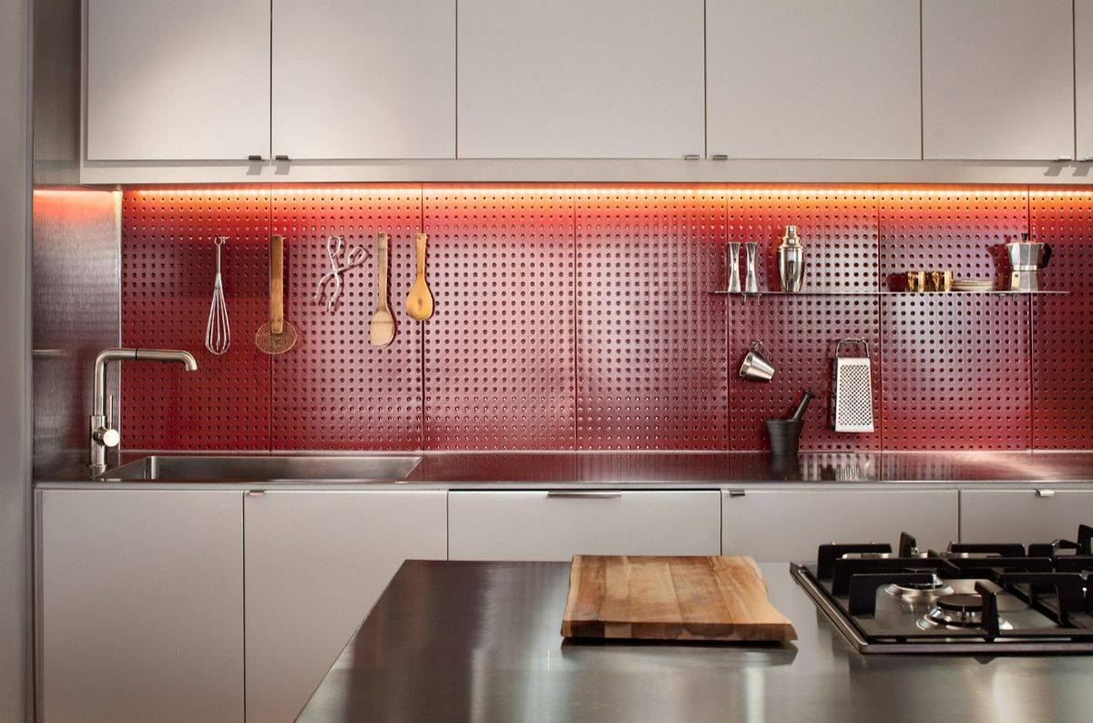 Custom-pegboard-backsplash-in-the-kitchen-also-adds-a-lovely-dash-of-bright-red-to-the-contemporary-space-62295