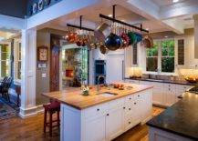 Elegant-and-simple-suspended-rails-act-as-the-pot-rack-in-this-traditional-kitchen-94659-217x155