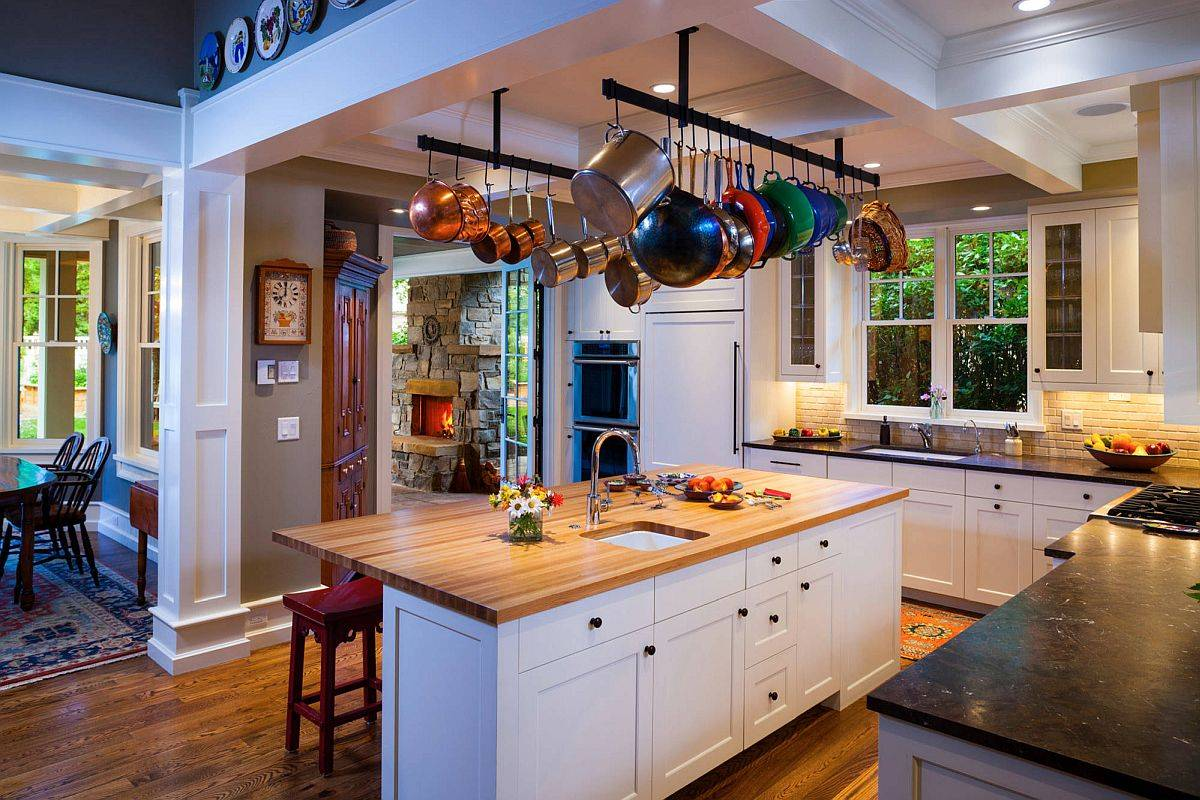 Elegant-and-simple-suspended-rails-act-as-the-pot-rack-in-this-traditional-kitchen-94659