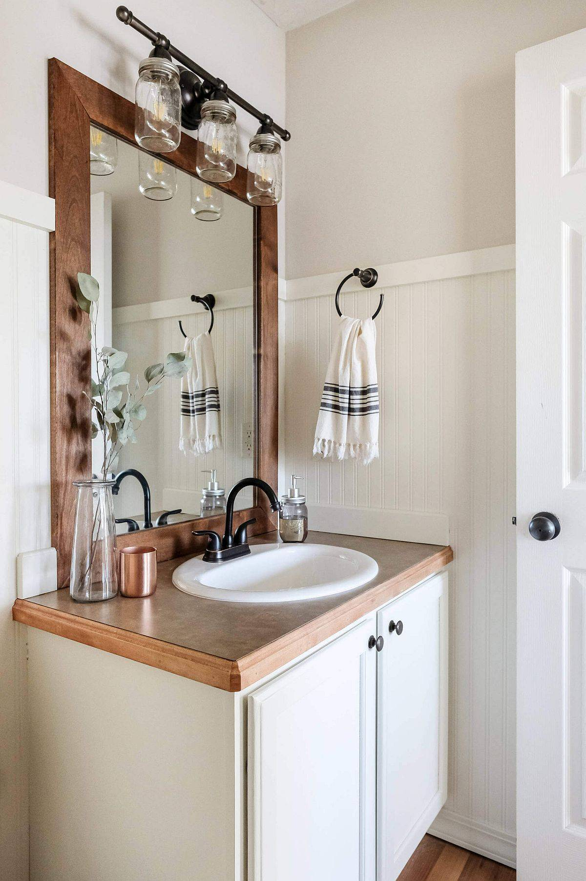 Innovative-lighting-with-farmhouse-influences-and-small-vanity-in-the-corner-make-an-impact-in-here-72244