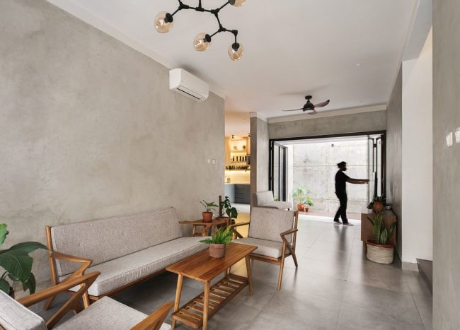 Living-area-on-the-inside-in-concrete-and-white-with-space-savvy-features-17613-217x155