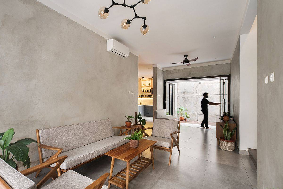 Living-area-on-the-inside-in-concrete-and-white-with-space-savvy-features-17613