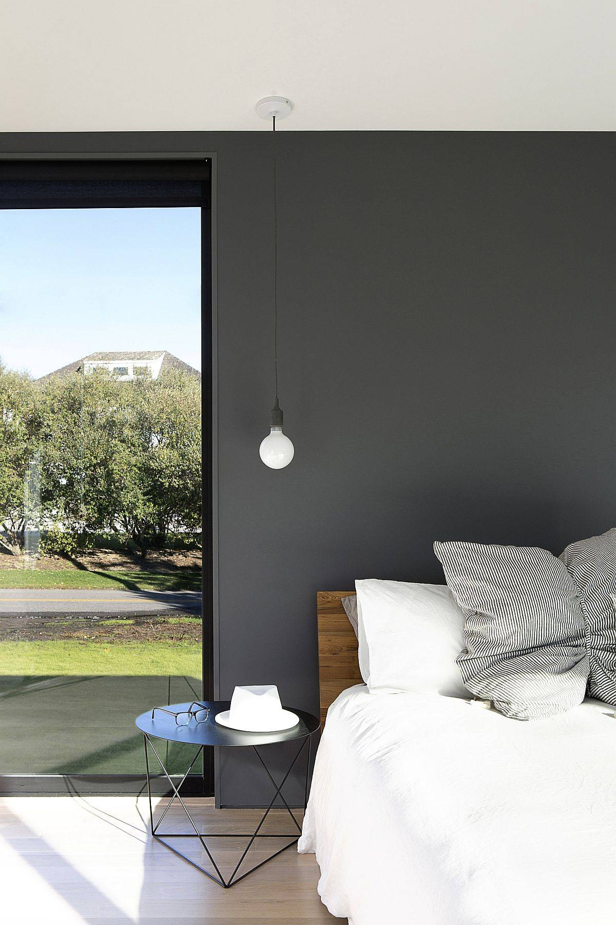Modern-bedroom-in-white-with-dark-gray-accent-wall-and-bedside-lighting-84141