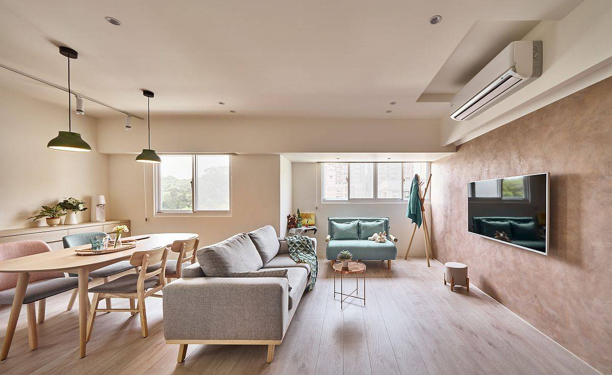 Modern living area and dining space of the small apartment in Taipei with a space-savvy design