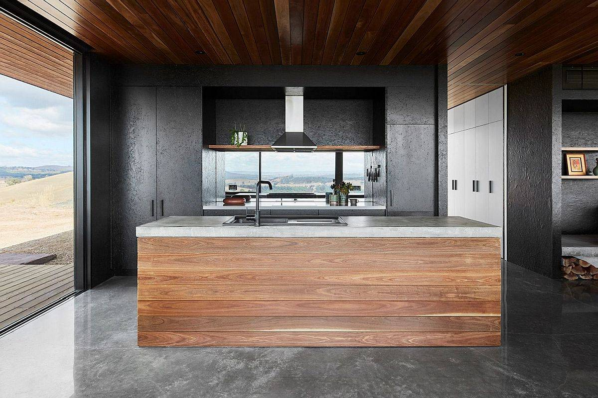 Oriented-strand-boards-painted-black-along-with-concrete-give-the-interior-a-sophisticated-backdrop-89942