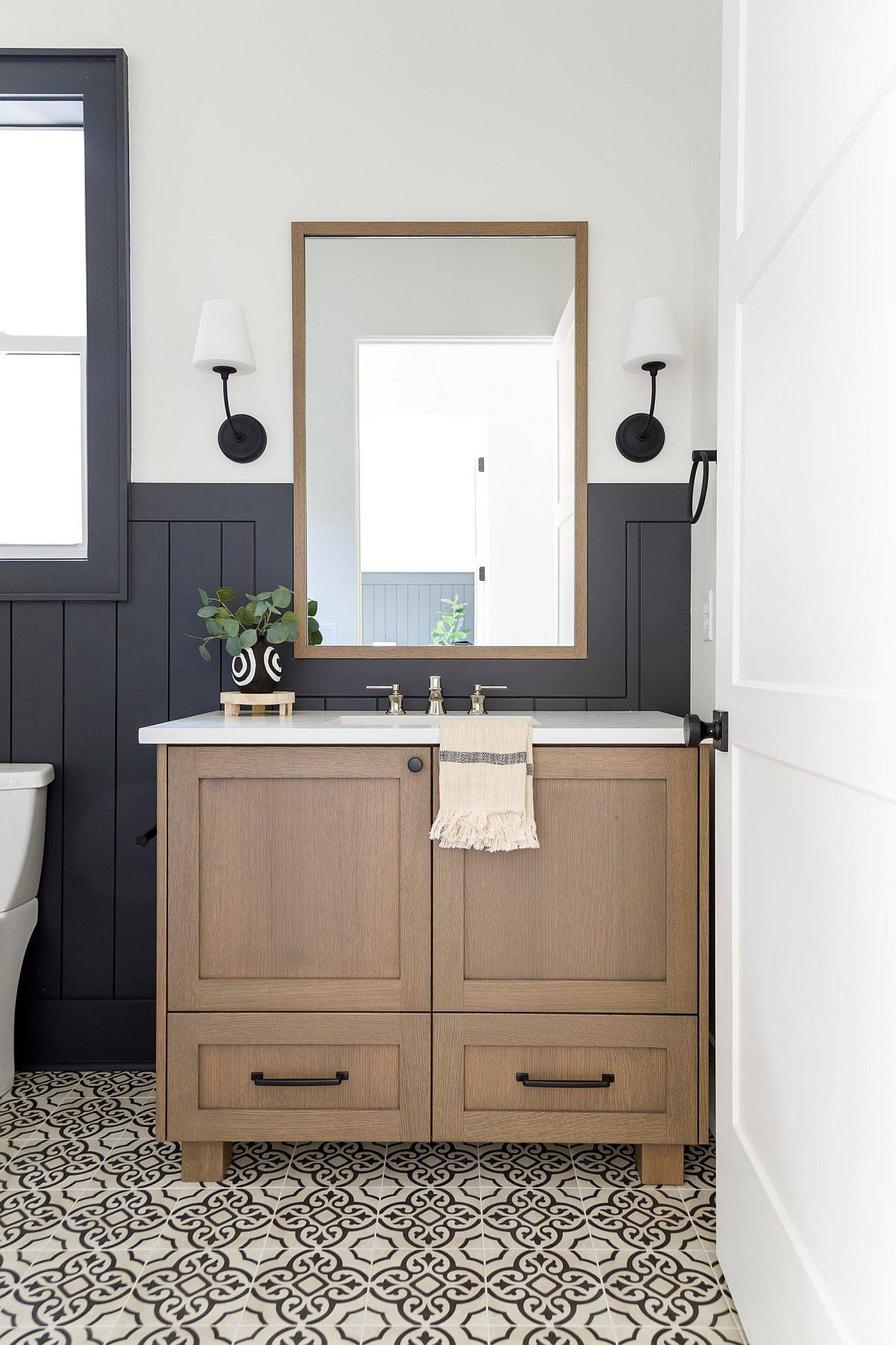 Painted-tile-on-the-floor-brings-pattern-to-the-small-bathroom-in-dark-gray-and-white-90219