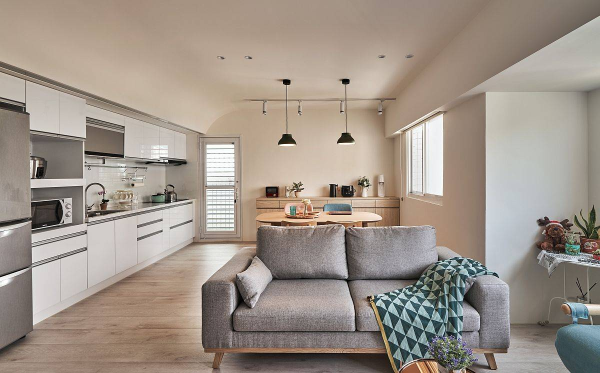Single-wall kitchen of the contemporary apartment in Taipei with small dining area next to it