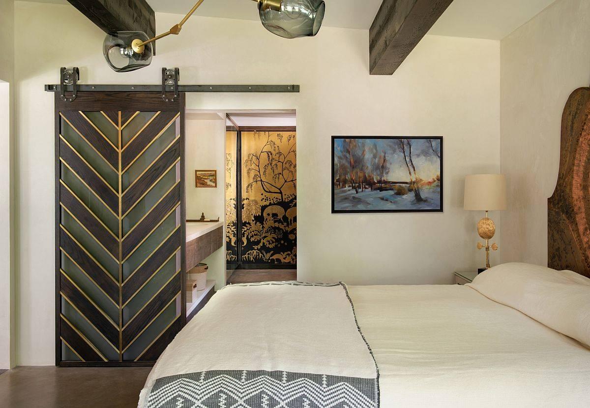Sliding barn door with chervron steals the spotlight in this bedroom